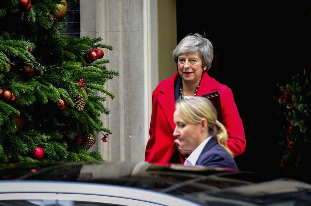 LONDON, Dec. 4, 2018 - British Prime Minister Theresa May (Rear) leaves 10 Downing Street in London, Britain, on Dec. 4, 2018. British MPs on Tuesday voted by 311 to 293 to find ministers in contempt ... - Theresa May