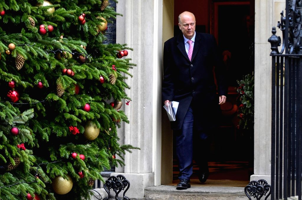 LONDON, Dec. 4, 2018 - British Transport Secretary Chris Grayling leaves 10 Downing Street after a cabinet meeting in London, Britain on Dec. 4, 2018. British MPs on Tuesday voted by 311 to 293 to ...
