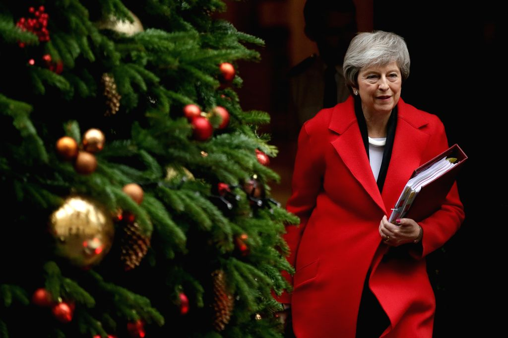 LONDON, Dec. 5, 2018 - British Prime Minister Theresa May leaves 10 Downing Street for upcoming Prime Minister's Questions (PMQs) at the House of Commons in London, Britain, Dec. 5, 2018. The British ... - Theresa May