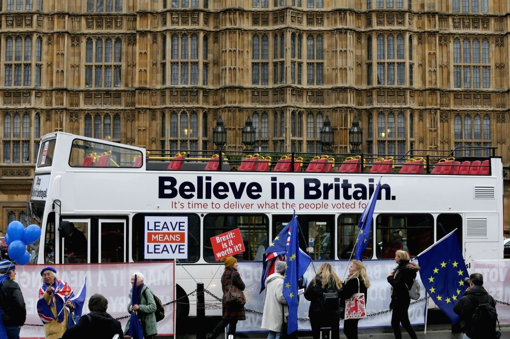 LONDON, Dec. 5, 2018 - Pro- and anti-Brexit protesters stand outside the House of Commons in London, Britain, Dec. 5, 2018. British Prime Minister Theresa May said the five-day Brexit debate which ... - Theresa May