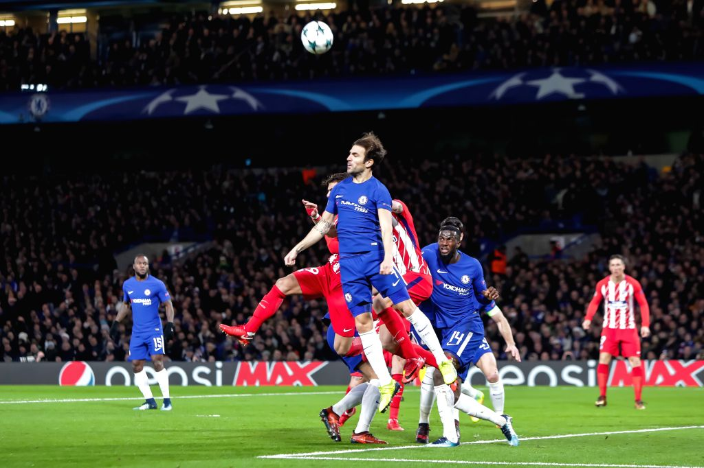 LONDON, Dec. 6, 2017 (Xinhua) -- Cesc Fabregas(Front) of Chelsea competes during the UEFA Champions League Group C match between Chelsea and Atletico Madrid at Stamford Bridge in London, Britain on Dec. 5, 2017. The match drew 1-1. (Xinhua/Richard Wa