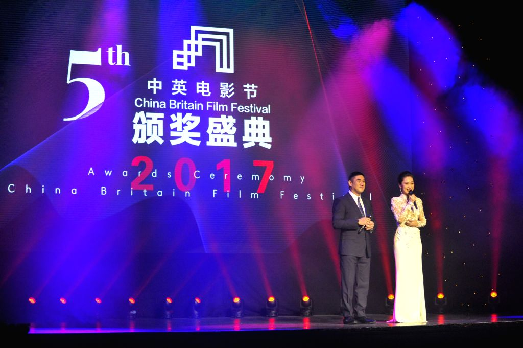 LONDON, Dec. 7, 2017 - David Wu (L) and Zhou Lanyu host the 5th China Britain Film Festival 2017 awards ceremony in London, Britain, on Dec. 6, 2017.