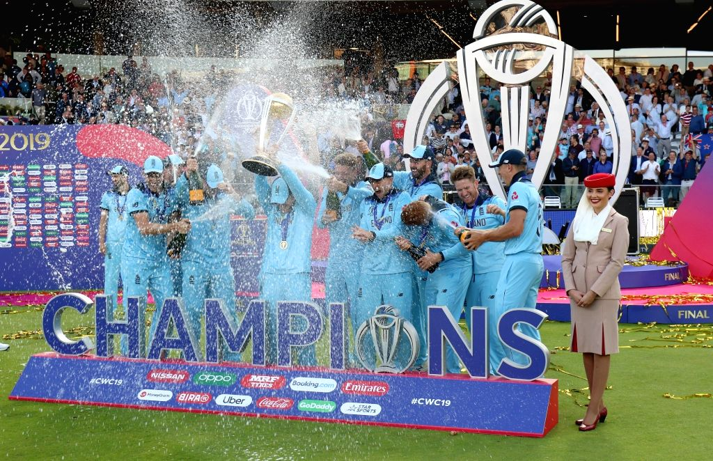 London: England captain Eoin Morgan kisses the 2019 World Cup at Lord's Cricket Ground in London on July 15, 2019. It took them 44 years, but England have finally done it. Neither a tied game, nor a spirited New Zealand could stop England from bringi - Eoin Morgan and Surjeet Yadav