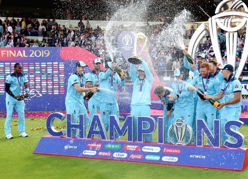 London: England captain Eoin Morgan with 2019 World Cup at Lord's Cricket Ground in London on July 15, 2019. It took them 44 years, but England have finally done it. Neither a tied game, nor a spirited New Zealand could stop England from bringing the - Eoin Morgan and Surjeet Yadav