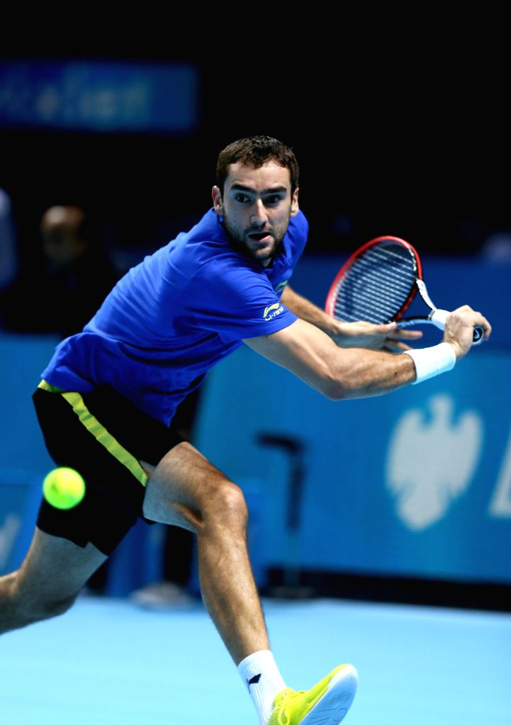 London (England): Marin Cilic of Croatia returns the ball during the ATP World Tour Finals Group A match against Novak Djokovic of Serbia in London, Britain on November 10, 2014. Cilic lost 0-2. ...