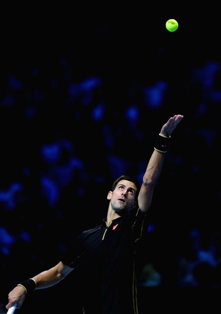London (England): Novak Djokovic of Serbia serves during the ATP World Tour Finals Group A match against Marin Cilic of Croatia in London, Britain on November 10, 2014. Djokovic won 2-0. (Xinhua/Han .