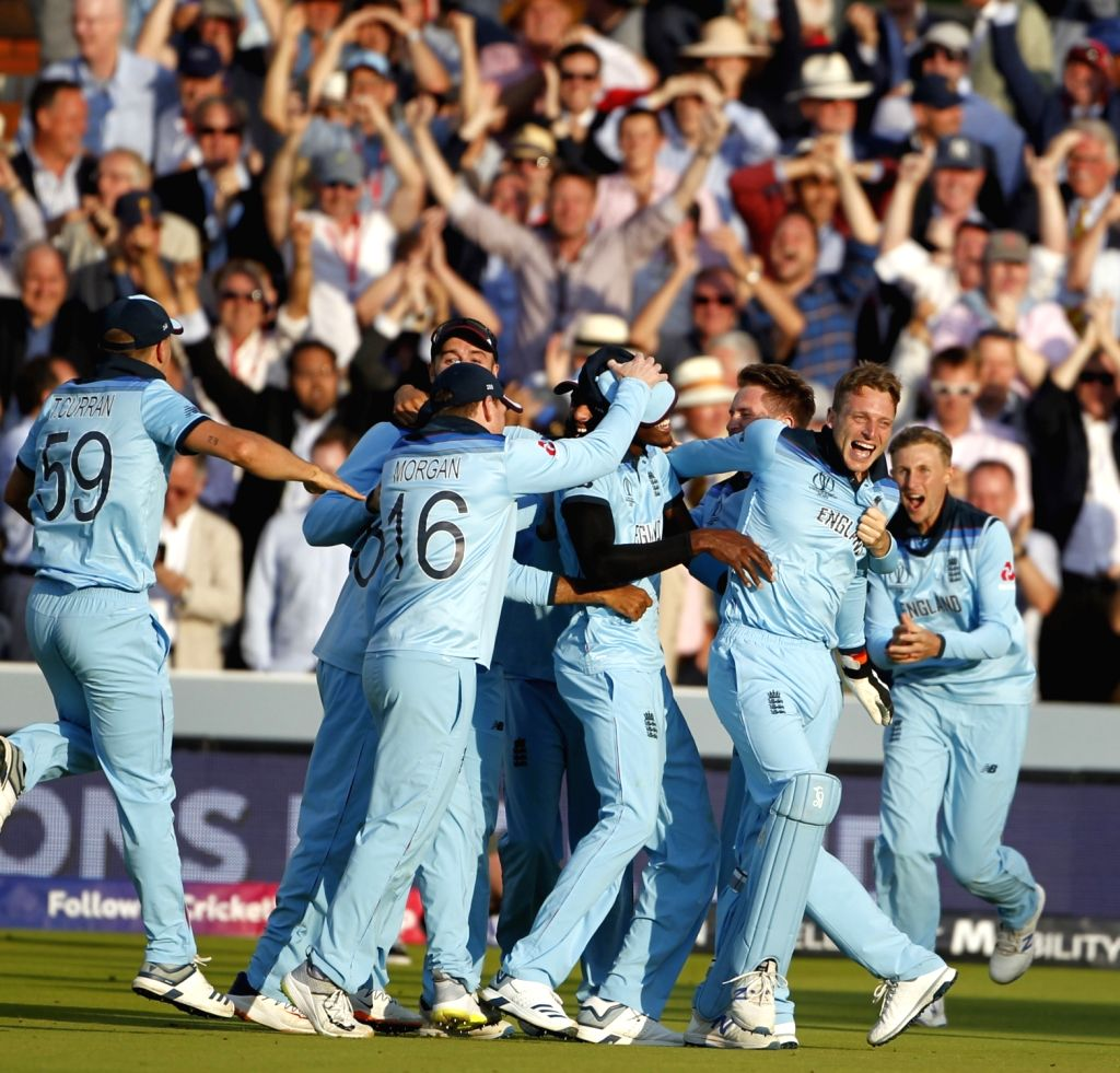 London: England players celebrate after winning the final match of the 2019 World Cup against New Zealand at the Lord's Cricket Stadium in London, England on July 14, 2019. (Photo: Surjeet Yadav/IANS) - Surjeet Yadav