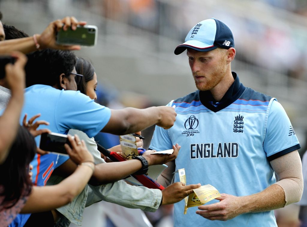 London: England's Ben Stokes signs autographs during the final match of the 2019 World Cup between New Zealand and England at the Lord's Cricket Stadium in London, England on July 14, 2019. (Photo: Surjeet Yadav/IANS) - Surjeet Yadav