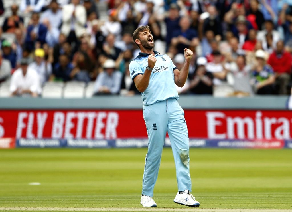 London: England's Liam Plunkett celebrates fall of James Neesham's wicket during the final match of the 2019 World Cup between New Zealand and England at the Lord's Cricket Stadium in London, England on July 14, 2019. (Photo: Surjeet Yadav/IANS) - Surjeet Yadav
