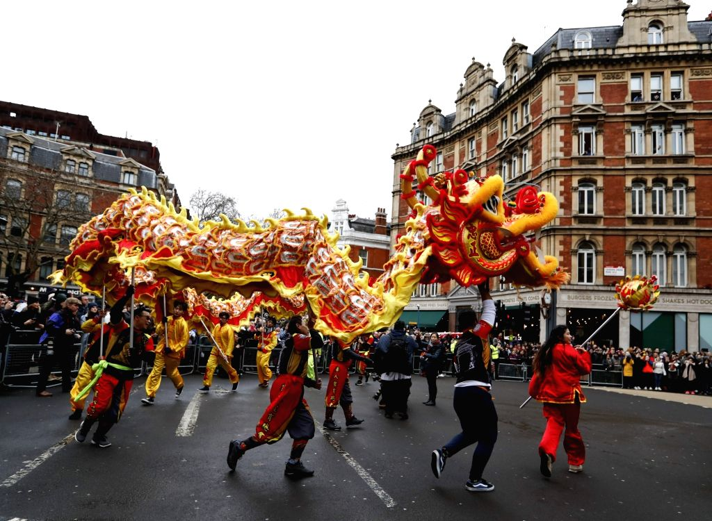 LONDON, Feb. 10, 2019 - People perform the dragon dance during a Chinese Lunar New Year parade in London, Britain, on Feb. 10, 2019. London hosted on Sunday one of the largest Chinese New Year ...