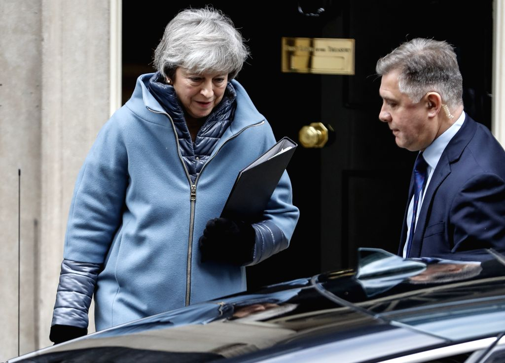 LONDON, Feb. 12, 2019 - British Prime Minister Theresa May (L) leaves 10 Downing Street to make a statement to the House of Commons to update on Brexit talks in London, Britain, Feb. 12, 2019. - Theresa May