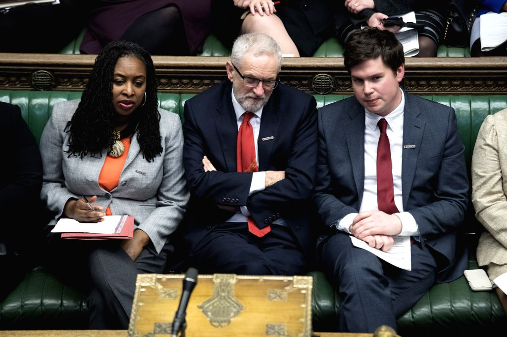LONDON, Feb. 14, 2019 - British Labour Party leader Jeremy Corbyn (C) attends the Prime Minister's Questions in the House of Commons in London, Britain, Feb. 13, 2019.