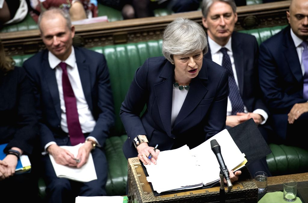 LONDON, Feb. 14, 2019 - British Prime Minister Theresa May attends the Prime Minister's Questions in the House of Commons in London, Britain, Feb. 13, 2019. (Xinhua/UK Parliament/Jessica Taylor) HOC ... - Theresa May