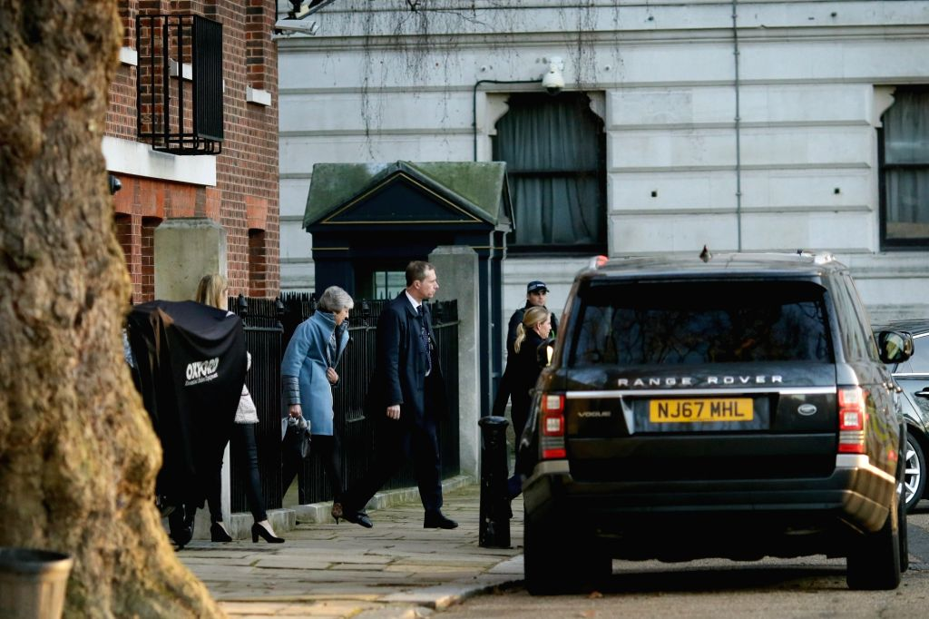 LONDON, Feb. 14, 2019 - British Prime Minister Theresa May (2nd L) leaves 10 Downing Street in London, Britain, on Feb. 14, 2019. The British House of Commons on Thursday voted against a motion ... - Theresa May