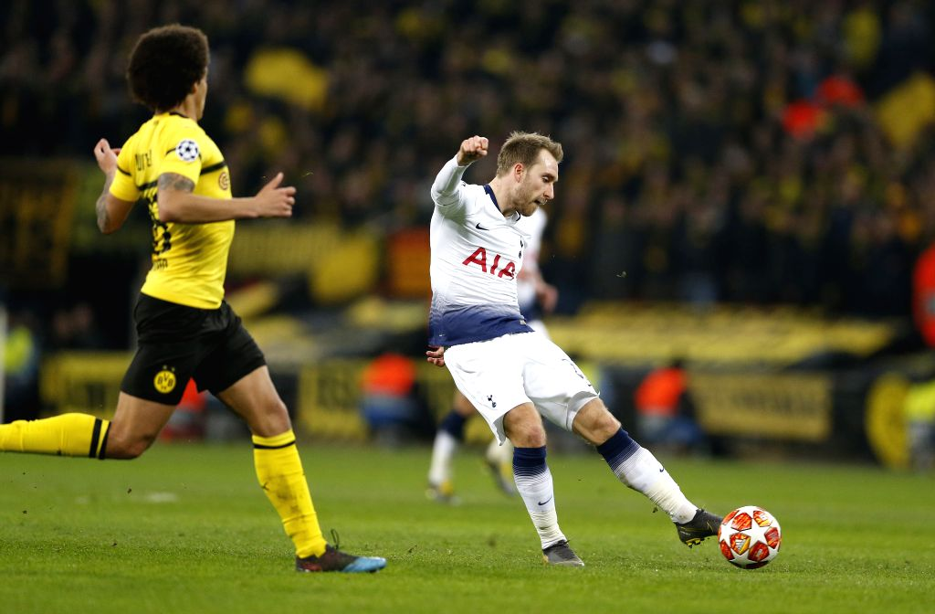 LONDON, Feb. 14, 2019 - Tottenham Hotspur's Christian Eriksen (R) shoots during the UEFA Champions League Round of 16 first Leg match between Tottenham Hotspur and Borussia Dortmund at Wembley ...