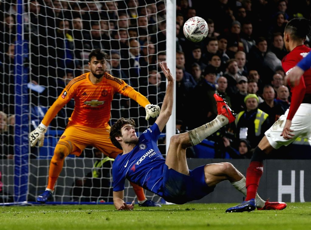 LONDON, Feb. 19, 2019 - Chelsea's Marcos Alonso (2nd L) makes a bicycle kick during the FA Cup fifth round match between Chelsea and Manchester United in London, Britain on Feb. 18, 2019. Manchester ...