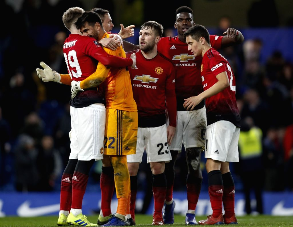 LONDON, Feb. 19, 2019 - Manchester United's players celebrate after winning the FA Cup fifth round match between Chelsea and Manchester United in London, Britain on Feb. 18, 2019. Manchester United ...