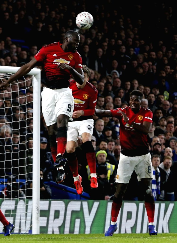 LONDON, Feb. 19, 2019 - Manchester United's Romelu Lukaku (L) heads for the ball during the FA Cup fifth round match between Chelsea and Manchester United in London, Britain on Feb. 18, 2019. ...