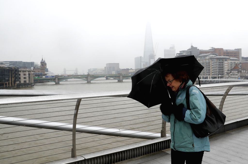 LONDON, Feb. 2, 2019 - A woman walks on Millennium Bridge in snow in London, Britain, Feb. 1, 2019. The Met Office on Friday issued a yellow warning for snow and ice after some parts of Britain ...