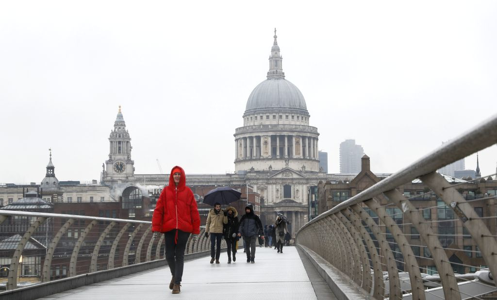LONDON, Feb. 2, 2019 - People walk in snow with St. Paul's Cathedral in the background in London, Britain, Feb. 1, 2019. The Met Office on Friday issued a yellow warning for snow and ice after some ...