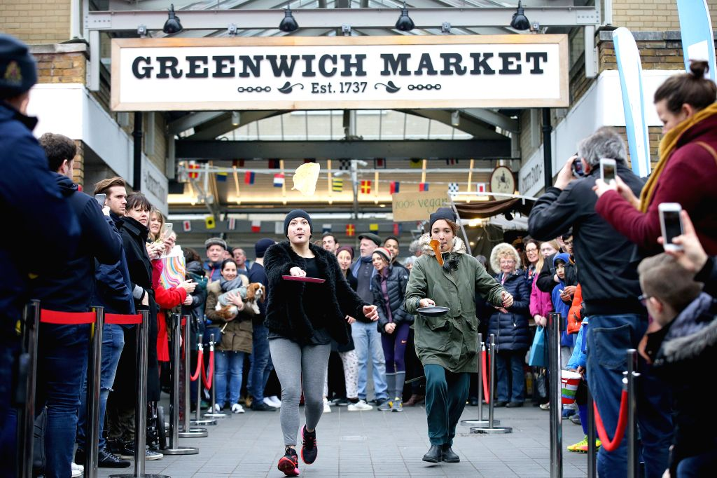 LONDON, Feb. 25, 2017 - People take part in an annual Greenwich Market pancake warmup race, named the Big Flippin' Warm Up, ahead of the grand final to take place on Shrove Tuesday at Greenwich ...