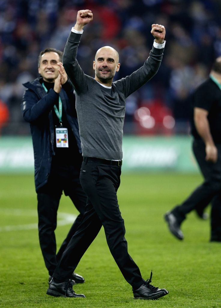 LONDON, Feb. 25, 2019 - Manchester City's manager Pep Guardiola celebrates victory after the Carabao Cup Final match between Chelsea and Manchester City at Wembley Stadium in London, Britain on Feb. ...