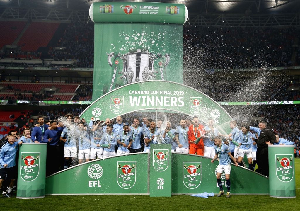 LONDON, Feb. 25, 2019 - Manchester City's players celebrate with the trophy after the Carabao Cup Final match between Chelsea and Manchester City at Wembley Stadium in London, Britain on Feb. 24, ...
