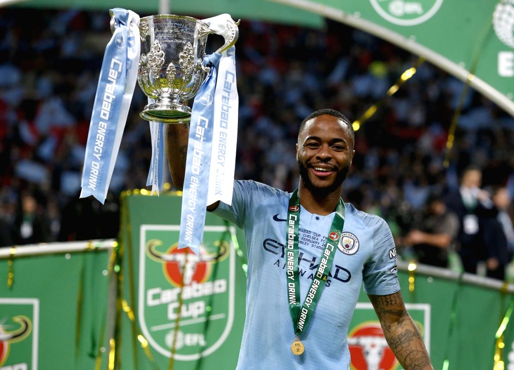 LONDON, Feb. 25, 2019 - Mancheter City's Raheem Sterling holds the Carabao Cup after the Carabao Cup Final match between Chelsea and Manchester City at Wembley Stadium in London, Britain on Feb. 24, ...