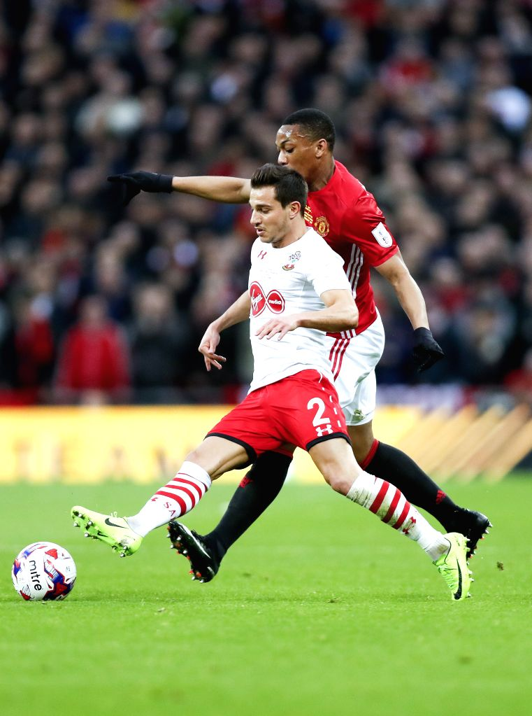 LONDON, Feb. 27, 2017 - Manchester United's Anthony Martial (R) vies with Southampton's Cedric during the EFL Cup Final between Manchester United and Southampton at Wembley Stadium in London, Britain ...