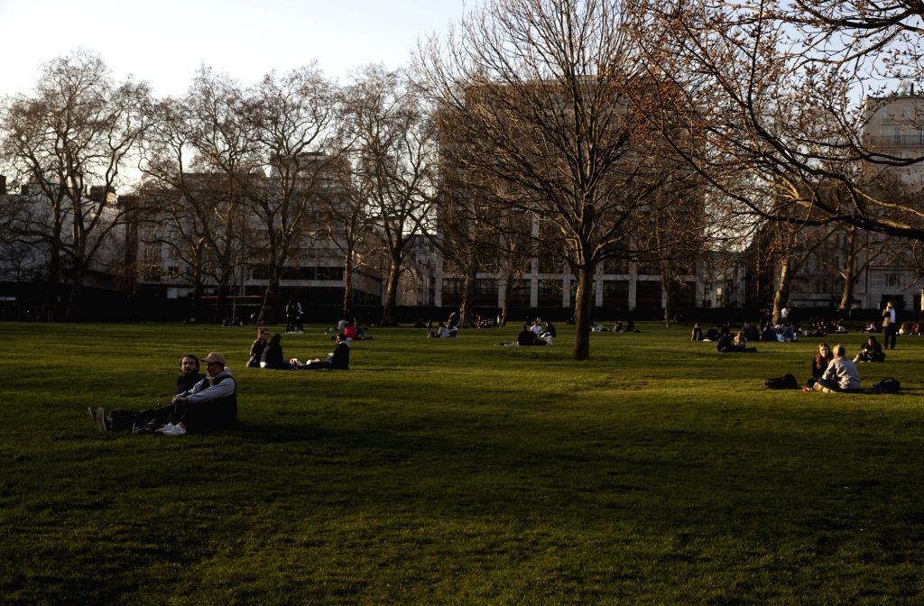 LONDON, Feb. 27, 2019 - People enjoy leisure time at the Green Park in London, Britain, on Feb. 26, 2019. Britain experienced its warmest February day on record Monday as the highest temperature ...