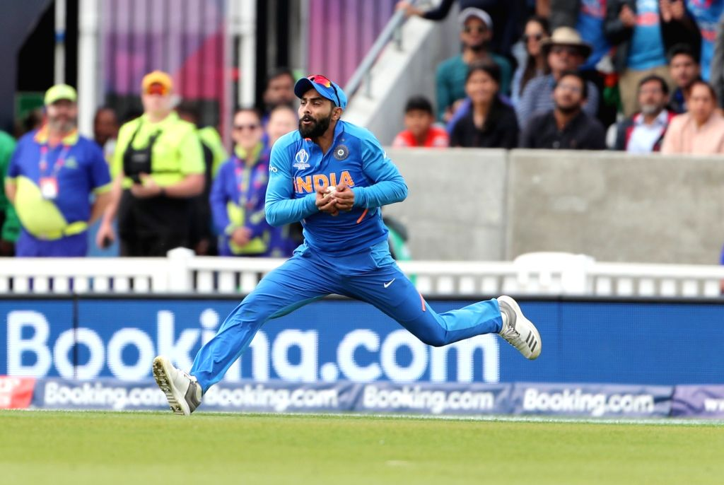 London: India's Ravindra Jadeja takes the catch of Glenn Maxwell during the 14th match of 2019 World Cup between India and Australia at Kennington Oval in London on June 9, 2019. (Photo: Surjeet Yadav/IANS) - Ravindra Jadeja and Surjeet Yadav
