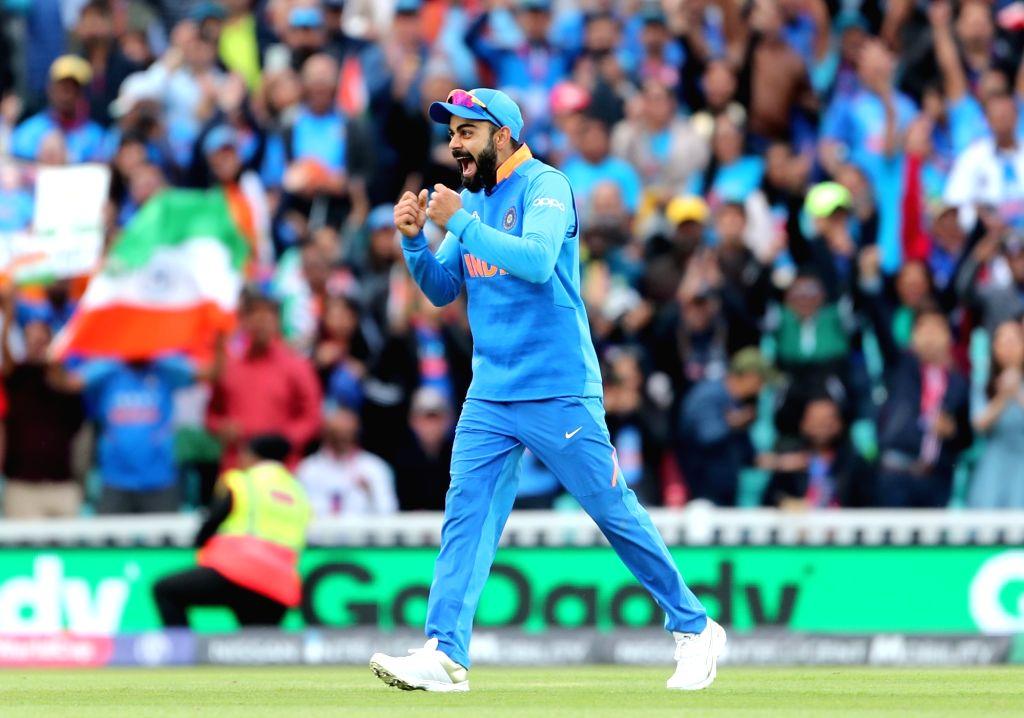 London: Indian skipper Virat Kohli celebrates after winning the 14th match of 2019 World Cup against Australia at Kennington Oval in London on June 9, 2019. India won by 36 runs. (Photo: Surjeet Yadav/IANS) - Virat Kohli and Surjeet Yadav