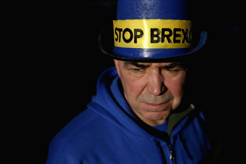 "LONDON, Jan. 17, 2018 - A demonstrator who wants Britain to remain in the European Union (EU) wears a hat reading ""Stop Brexit"" outside the Houses of Parliament in London, Britain, on Jan. ..."