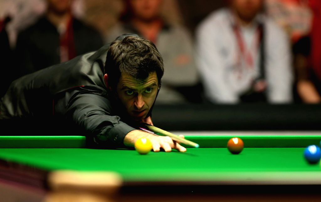 Ronnie O'Sullivan of England competes during the 2015 Snooker Masters semifinal against Neil Robertson of Australia at the Alexandra Palace in London, capital of ...