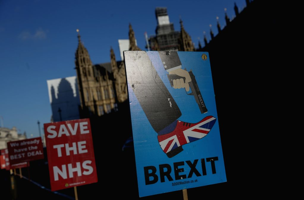 LONDON, Jan. 22, 2019 - Photo taken on Jan. 22, 2019 shows the placards by demonstrators outside the Houses of Parliament in central London, Britain. British Prime Minister Theresa May said on Monday ... - Theresa May