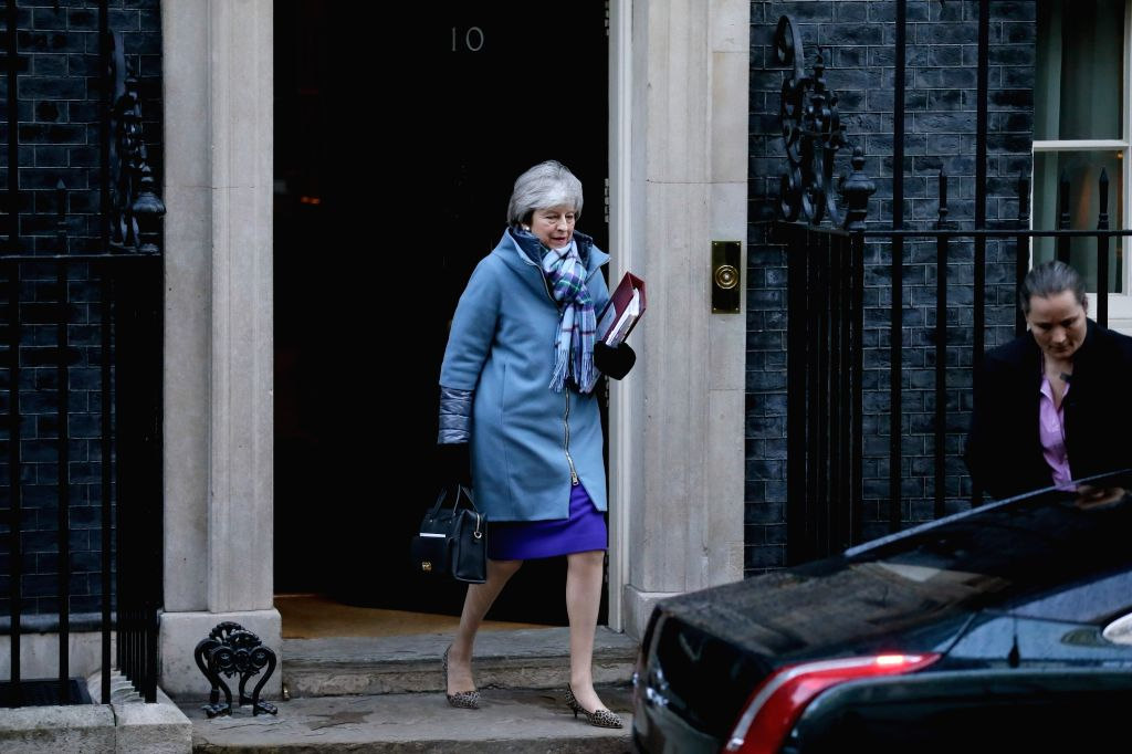 London, Jan. 30, 2019 (Xinhua) British Prime Minister Theresa May leaves 10 Downing Street for Prime Minister's Questions in the House of Commons in London, Britain, on Jan. 30, 2019. The British House of Commons on Tuesday passed an amendment to all - Theresa May