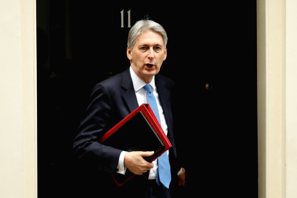 LONDON, Jan. 9, 2019 (Xinhua) -- Britain's Chancellor of the Exchequer Philip Hammond is seen in front of 11 Downing Street in London, Britain, on Jan 9, 2019. Britain's Brexit debate in the House of Commons on the proposed agreement on the terms of