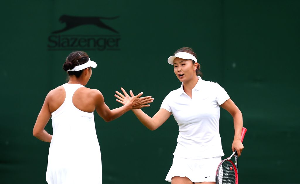 LONDON, July 1, 2016 - Peng Shuai (R) and Zhang Shuai of China celebrate scoring during the women's doubles first round match against Hsieh Su-Wei of Chinese Taipei and Nicole Melichar of the United ...