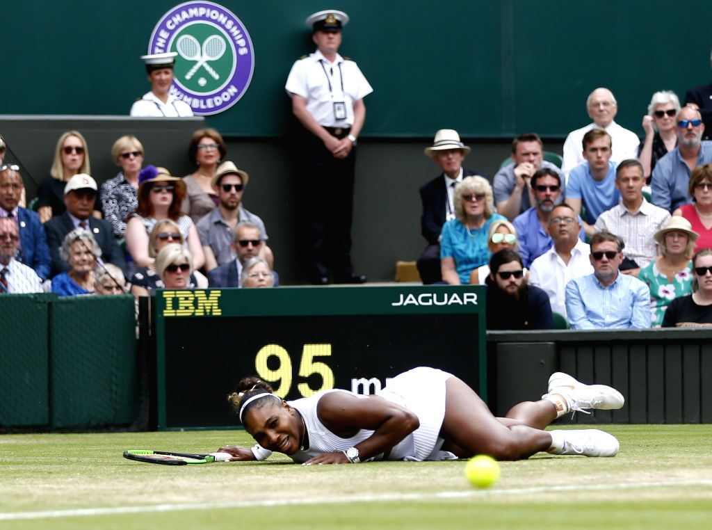 LONDON, July 10, 2019 (Xinhua) -- Serena Williams of the United States competes during the women's singles quarterfinal match with her compatriot Alison Riske at the 2019 Wimbledon Tennis  Championships in London, Britain, on July 9, 2019. (Xinhua/Ha