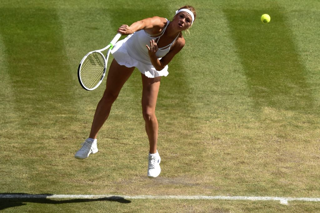 LONDON, July 11, 2018 - Camila Giorgi of Italy serves during the women's singles quarterfinal match against Serena Williams of the United
