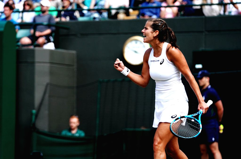LONDON, July 11, 2018 - Julia Goerges of Germany celebrates during the women's singles quarterfinal match against Kiki Bertens of the Netherlands at the Wimbledon Championships 2018 in London, ...