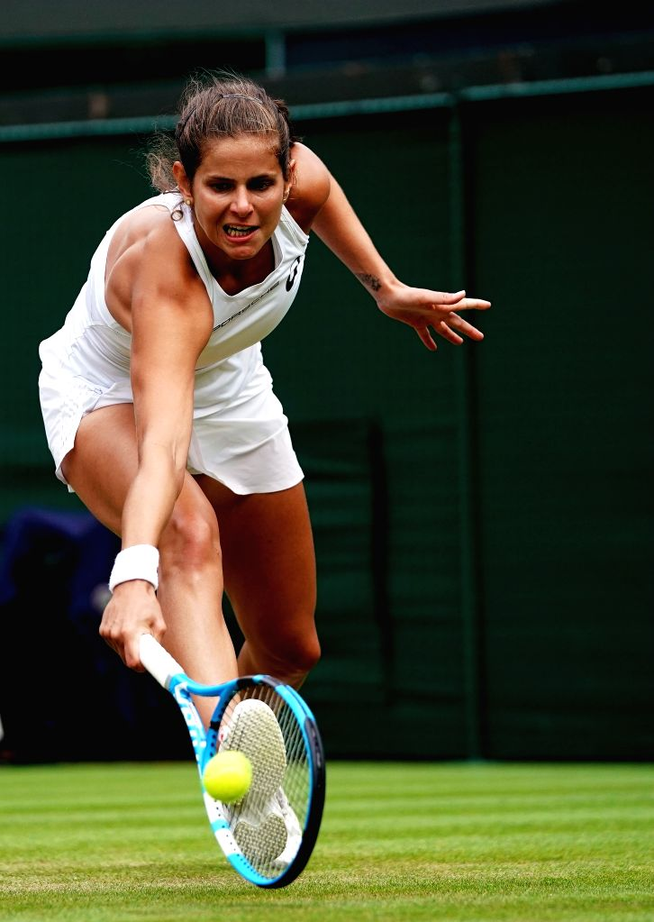 LONDON, July 11, 2018 - Julia Goerges of Germany hits a return during the women's singles quarterfinal match against Kiki Bertens of the Netherlands at the Wimbledon Championships 2018 in London, ...