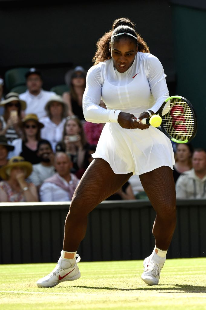 LONDON, July 11, 2018 - Serena Williams of the United States hits a return during the women's singles quarterfinal match against Camila Giorgi of Italy at the Wimbledon Championships 2018 in London, ...