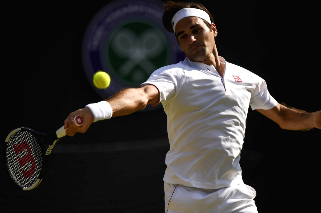 LONDON, July 12, 2018 - Roger Federer of Switzerland hits a return during the men's singles quarterfinal match against Kevin Anderson of South Africa at the Wimbledon Championships 2018 in London, ...