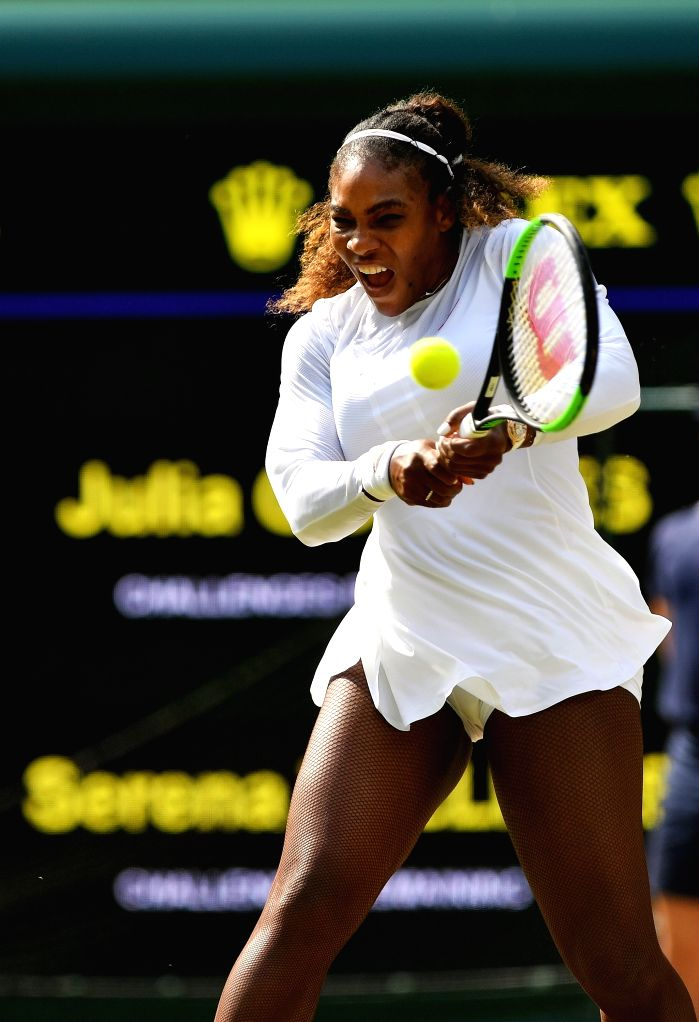 LONDON, July 13, 2018 - Serena Williams of the United States hits a return during the women's singles semifinal match against Julia Goerges of Germany at the Championship Wimbledon 2018 in London, ...
