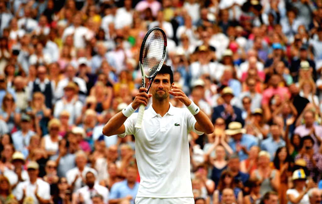 LONDON, July 14, 2018 - Novak Djokovic of Serbia reacts after the men's singles semifinal match against Rafael Nadal of Spain at the Wimbledon Championships 2018 in London, Britain, on July 13, 2018. ...