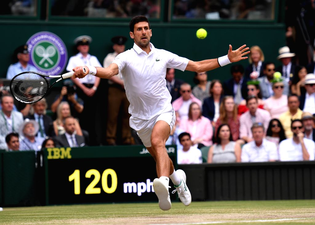 LONDON, July 14, 2019 (Xinhua) -- Novak Djokovic of Serbia competes during the men's singles final match between Novak Djokovic of Serbia and Roger Federer of Switzerland at the 2019 Wimbledon Tennis Championships in London, Britain, July 14, 2019. (