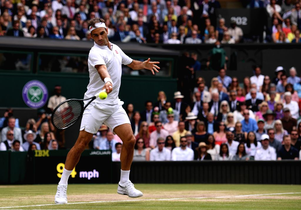 LONDON, July 14, 2019 (Xinhua) -- Roger Federer of Switzerland competes during the men's singles final match between Novak Djokovic of Serbia and Roger Federer of Switzerland at the 2019 Wimbledon Tennis Championships in London, Britain, July 14, 201