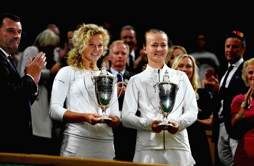 LONDON, July 15, 2018 - Barbora Krejcikova (R front) and Katerina Siniakova (L front) of the Czech Republic, show their trophies of champions of the Ladies' Doubles at the Wimbledon Championships ...