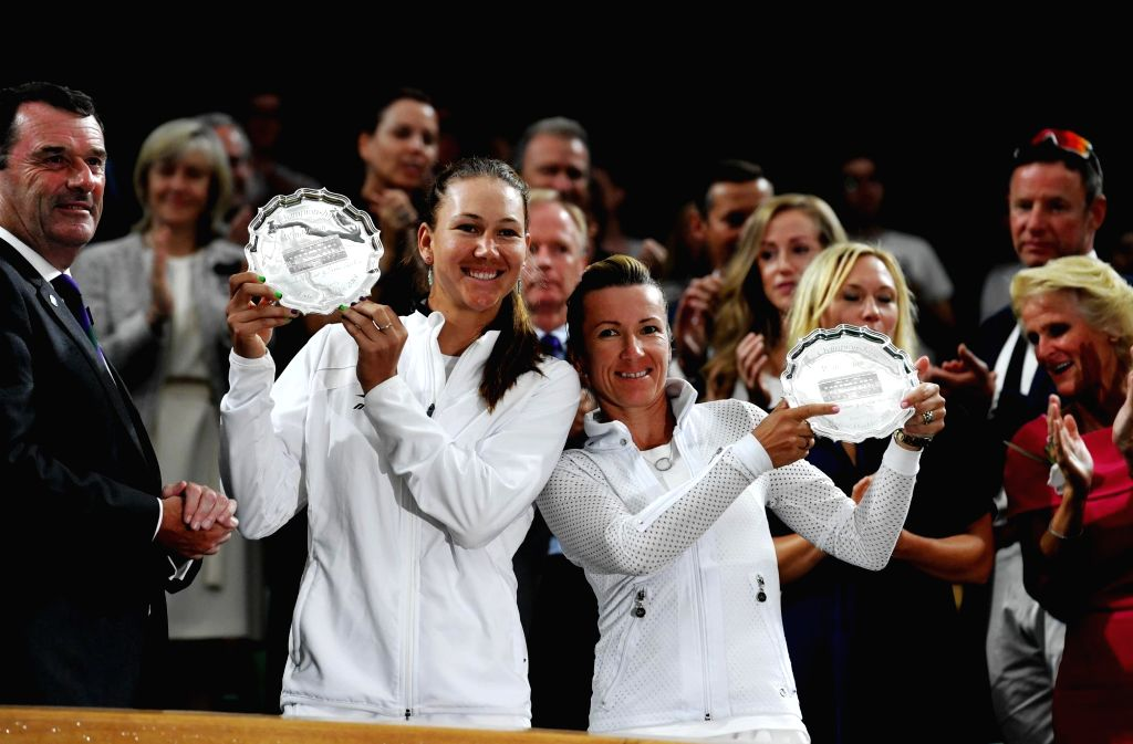 LONDON, July 15, 2018 - Nicole Melichar (2nd L, front) of the United States and Kveta Peschke (3rd L, front) of the Czech Republic show their trophies of the second place of the Ladies' Doubles at ...